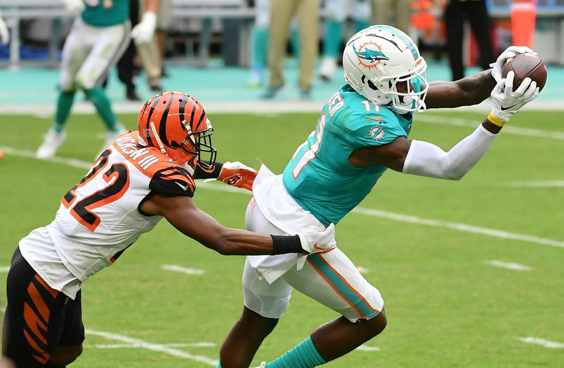 Dec 6, 2020; Miami Gardens, Florida, USA; Miami Dolphins wide receiver DeVante Parker (11) makes a catch in front of Cincinnati Bengals cornerback William Jackson (22) during the second half at Hard Rock Stadium. Mandatory Credit: Jasen Vinlove-USA TODAY Sports