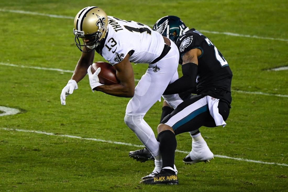 Saints' Michael Thomas (13) makes a reception over Eagles' Darius Slay (24) Sunday, Dec. 13, 2020 in Philadelphia. The Eagles won 24-21.  Jl Eagles 121320 08