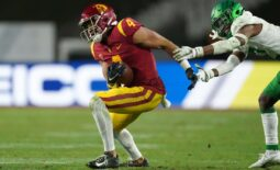 Dec 18, 2020; Los Angeles, California, USA; Southern California Trojans wide receiver Bru McCoy (4) is defended by Oregon Ducks cornerback Mykael Wright (2) during the Pac-12 Championship at United Airlines Field at Los Angeles Memorial Coliseum. Oregon defeated USC 31-24. Mandatory Credit: Kirby Lee-USA TODAY Sports