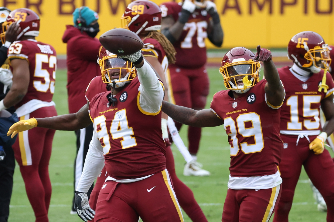 Dec 20, 2020; Landover, Maryland, USA; Washington Football Team nose tackle Daron Payne (94) celebrates with teammates after intercepting a pass against the Seattle Seahawks in the fourth quarter at FedExField. Mandatory Credit: Geoff Burke-USA TODAY Sports