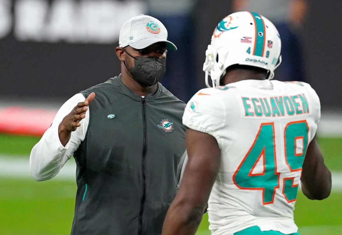 Dec 26, 2020; Paradise, Nevada, USA; Miami Dolphins head coach Brian Flores (left) greets linebacker Sam Eguavoen (right) before their game against the Las Vegas Raiders at Allegiant Stadium. Mandatory Credit: Kirby Lee-USA TODAY Sports