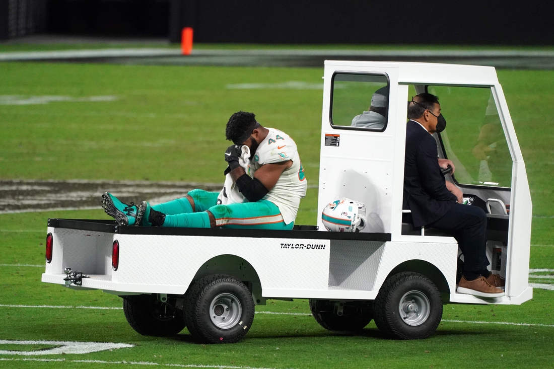 Dec 26, 2020; Paradise, Nevada, USA; Miami Dolphins outside linebacker Elandon Roberts (44) is taken off the field with an injury in the second half against the Las Vegas Raiders at Allegiant Stadium. The Dolphins defeated the Raiders 26-25. Mandatory Credit: Kirby Lee-USA TODAY Sports