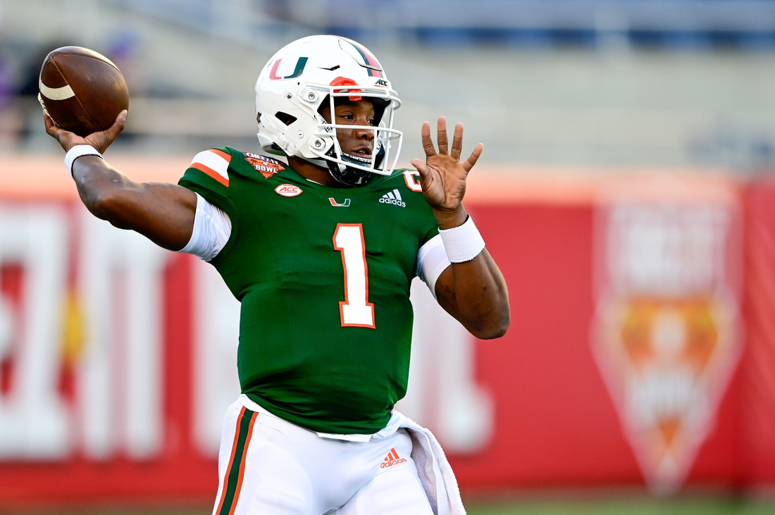 Dec 29, 2020; Orlando, FL, USA; Miami Hurricanes quarterback D'Eriq King (1) warms up prior to the game between the Oklahoma State Cowboys and the Miami Hurricanes during the Cheez-It Bowl Game at Camping World Stadium. Mandatory Credit: Douglas DeFelice-USA TODAY Sports