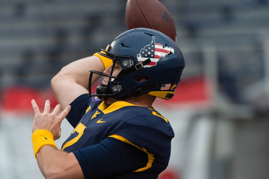 Dec 31, 2020; Memphis, TN, USA; West Virginia Mountaineers quarterback Jarret Doege (2) warms up before the game against the Army Black Knights  at Liberty Bowl Stadium. Mandatory Credit: Justin Ford-USA TODAY Sports