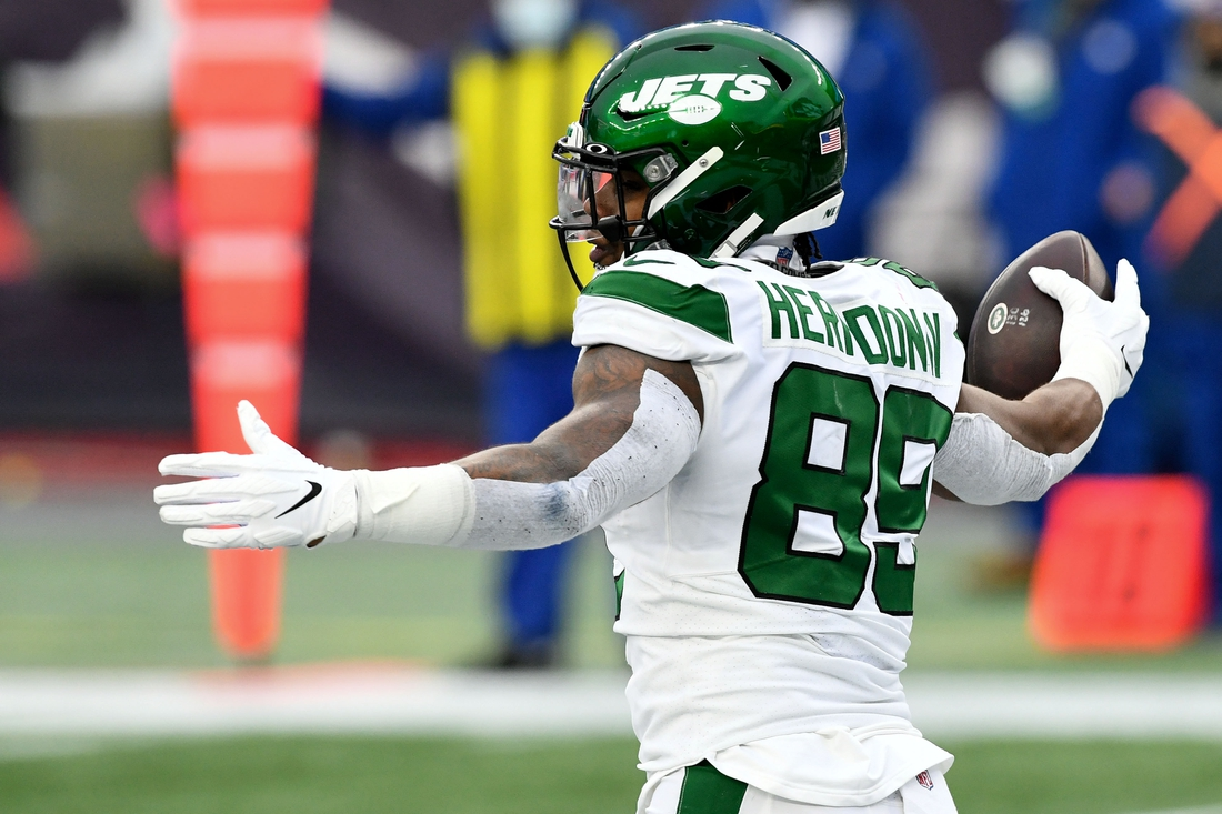 Jan 3, 2021; Foxborough, Massachusetts, USA; New York Jets tight end Chris Herndon (89) celebrates after scoring a touchdown against the New England Patriots during the second quarter at Gillette Stadium. Mandatory Credit: Brian Fluharty-USA TODAY Sports