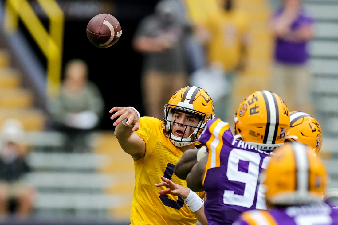 Apr 17, 2021; Baton Rouge, Louisiana, USA;  LSU Tigers quarterback Garrett Nussmeier (5) passes the ball against LSU Tigers defensive end Neil Farrell Jr. (92) during the second half of the annual Purple and White spring game at Tiger Stadium. Mandatory Credit: Stephen Lew-USA TODAY Sports