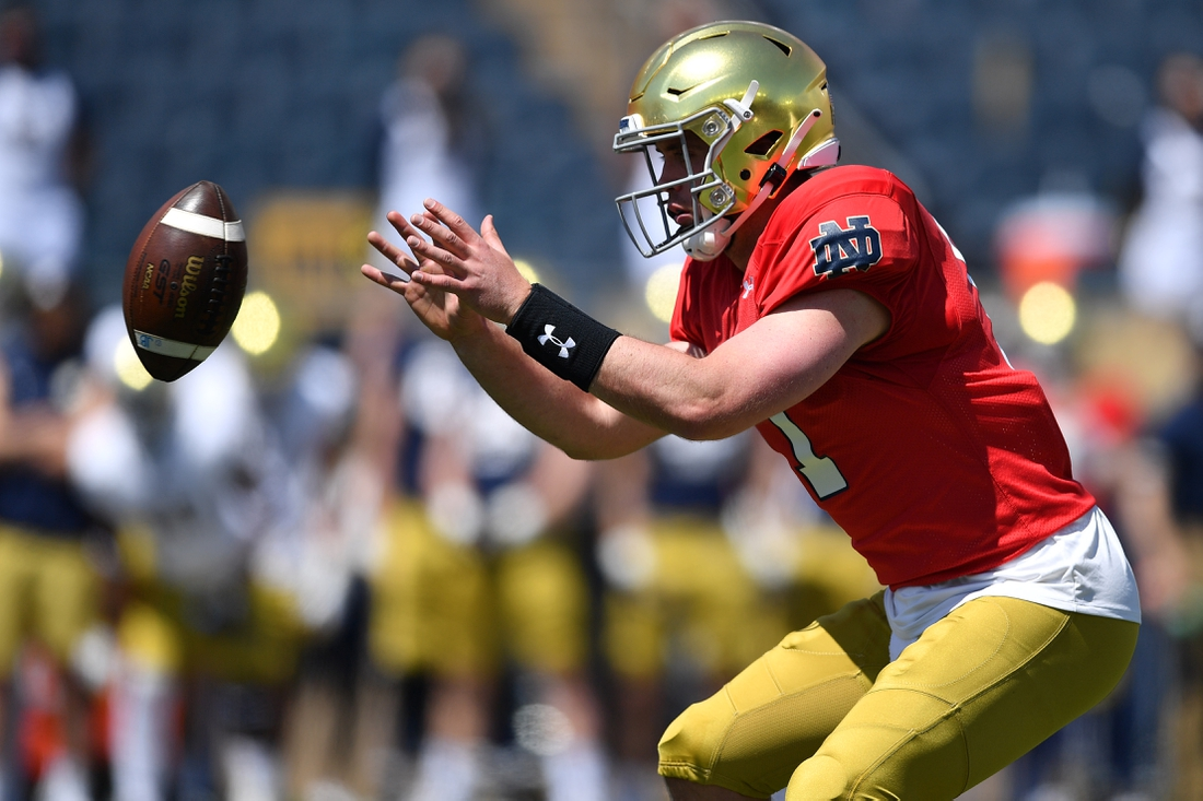 May 1, 2021; Notre Dame, Indiana, USA; Notre Dame Fighting Irish quarterback Jack Coan (17) takes the snap in the first half of the Blue-Gold Game at Notre Dame Stadium. Mandatory Credit: Matt Cashore-USA TODAY Sports