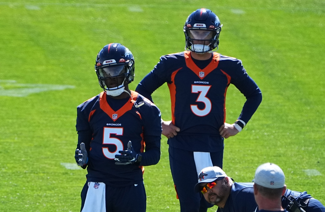 Jun 1, 2021; Englewood, Colorado, USA; Denver Broncos quarterback Teddy Bridgewater (5) and quarterback Drew Lock (3) during organized team activities at the UCHealth Training Center. Mandatory Credit: Ron Chenoy-USA TODAY Sports