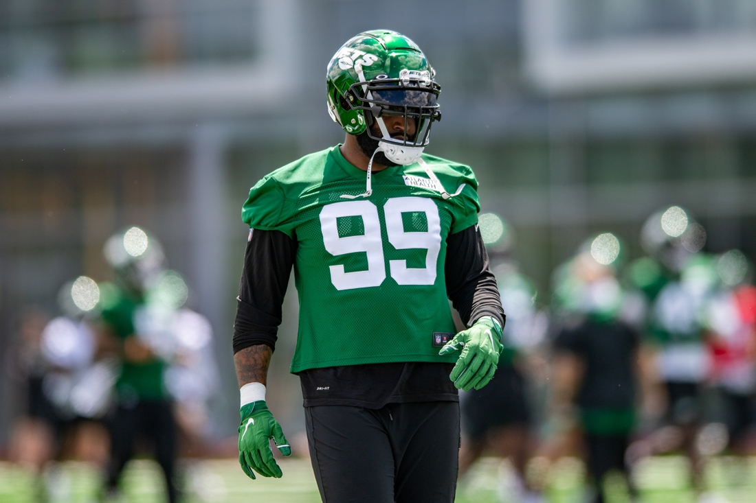 May 27, 2021; Florham Park, NJ, USA; New York Jets defensive end Vinny Curry (99) participates in a drill during an OTA at Jets Atlantic Health Training Center. Mandatory Credit: John Jones-USA TODAY Sports