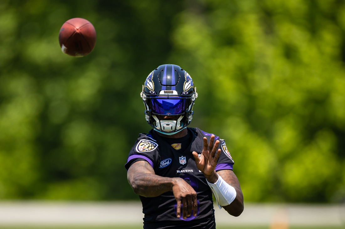 May 26, 2021; Owings Mills, Maryland, USA; Baltimore Ravens quarterback Lamar Jackson (8) passes the ball during an OTA at Under Armour Performance Center. Mandatory Credit: Scott Taetsch-USA TODAY Sports