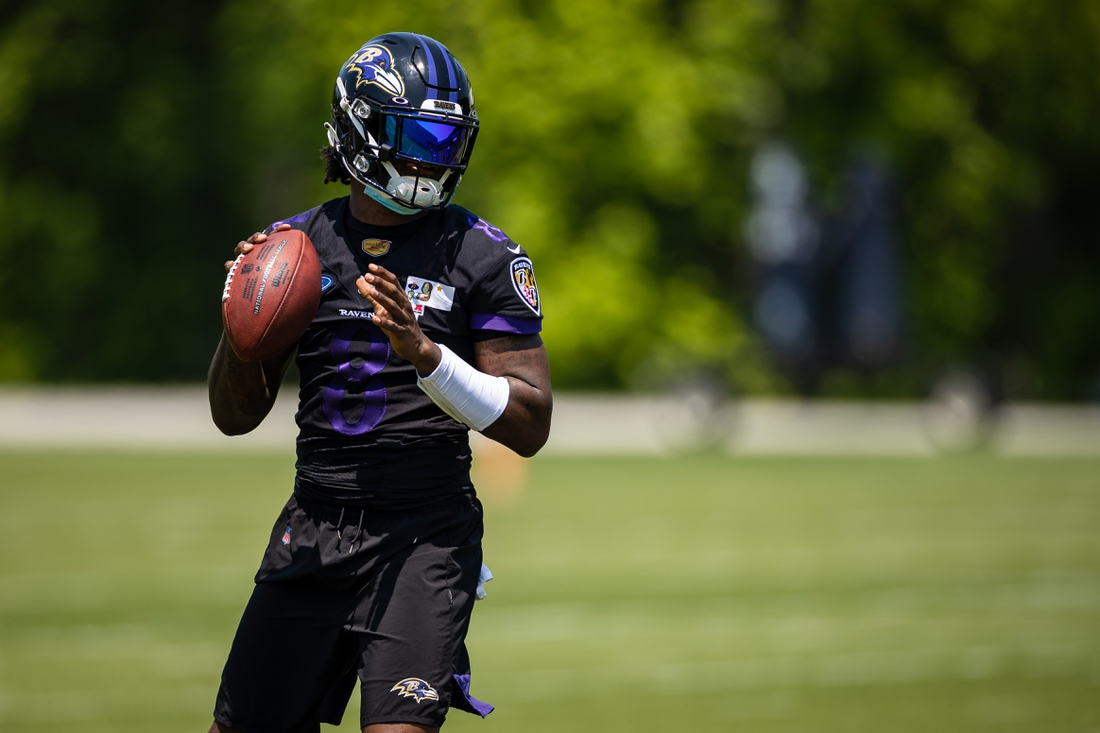 May 26, 2021; Owings Mills, Maryland, USA; Baltimore Ravens quarterback Lamar Jackson (8) in action during an OTA at Under Armour Performance Center. Mandatory Credit: Scott Taetsch-USA TODAY Sports