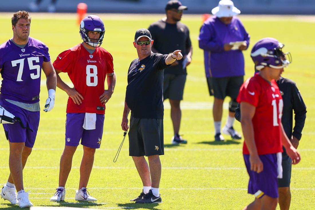 Jun 15, 2021; in Eagen, Minnesota, USA; Minnesota Vikings head coach Mike Zimmer and quarterback Kirk Cousins (8) talk during drills at OTA at TCO Performance Center. Mandatory Credit: Harrison Barden-USA TODAY Sports