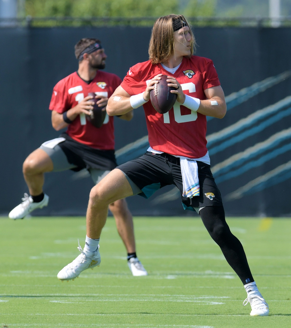 Jaguars quarterbacks (15) Gardner Minshew II and (16) Trevor Lawrence during drills at Tuesday's minicamp session. The Jacksonville Jaguars held their Tuesday morning session of the team's mandatory minicamp at the practice fields outside TIAA Bank Field, June 15, 2021.  Jki 061521 Jaguarsveteransminicamp 04