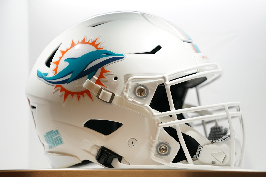 Jul 20, 2021; Miami Gardens, FL, USA; A general view of a Miami Dolphins helmet in the locker room during the grand opening at Baptist Health Training Complex. Mandatory Credit: Jasen Vinlove-USA TODAY Sports