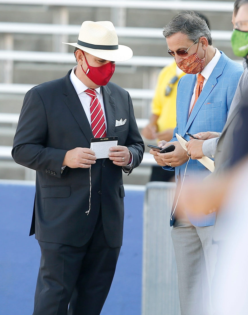 OU athletic director Joe Castiglione talks with Texas athletic director Chris Del Conte before last season's Red River Showdown football game in Dallas.  castiglione del conte