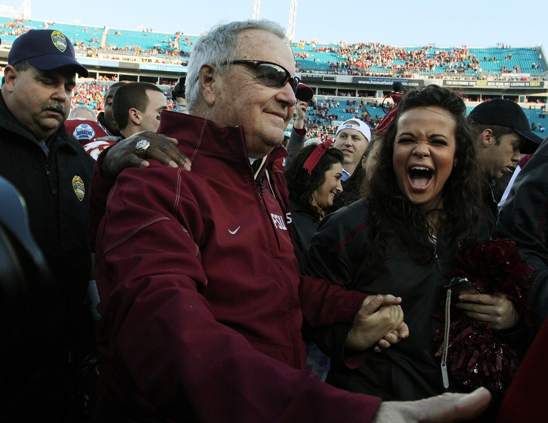 Jan. 1, 2010: A fan smiles as she congratulates FSU coach Bobby Bowden after his final game against West Virginia at Jacksonville Municipal Stadium for the Gator Bowl. [Kelly Jordan, Florida Times-Union]