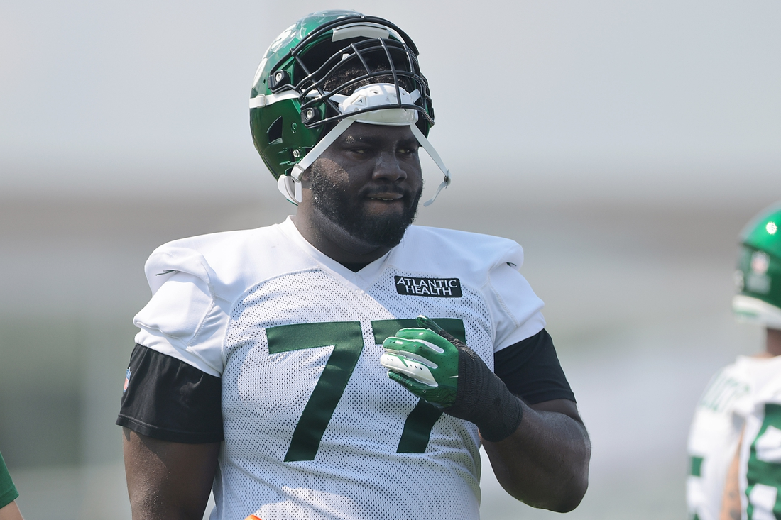 Jul 28, 2021; Florham Park, NJ, United States; New York Jets offensive tackle Mekhi Becton (77) looks on during training camp at Atlantic Health Jets Training Center. Mandatory Credit: Vincent Carchietta-USA TODAY Sports
