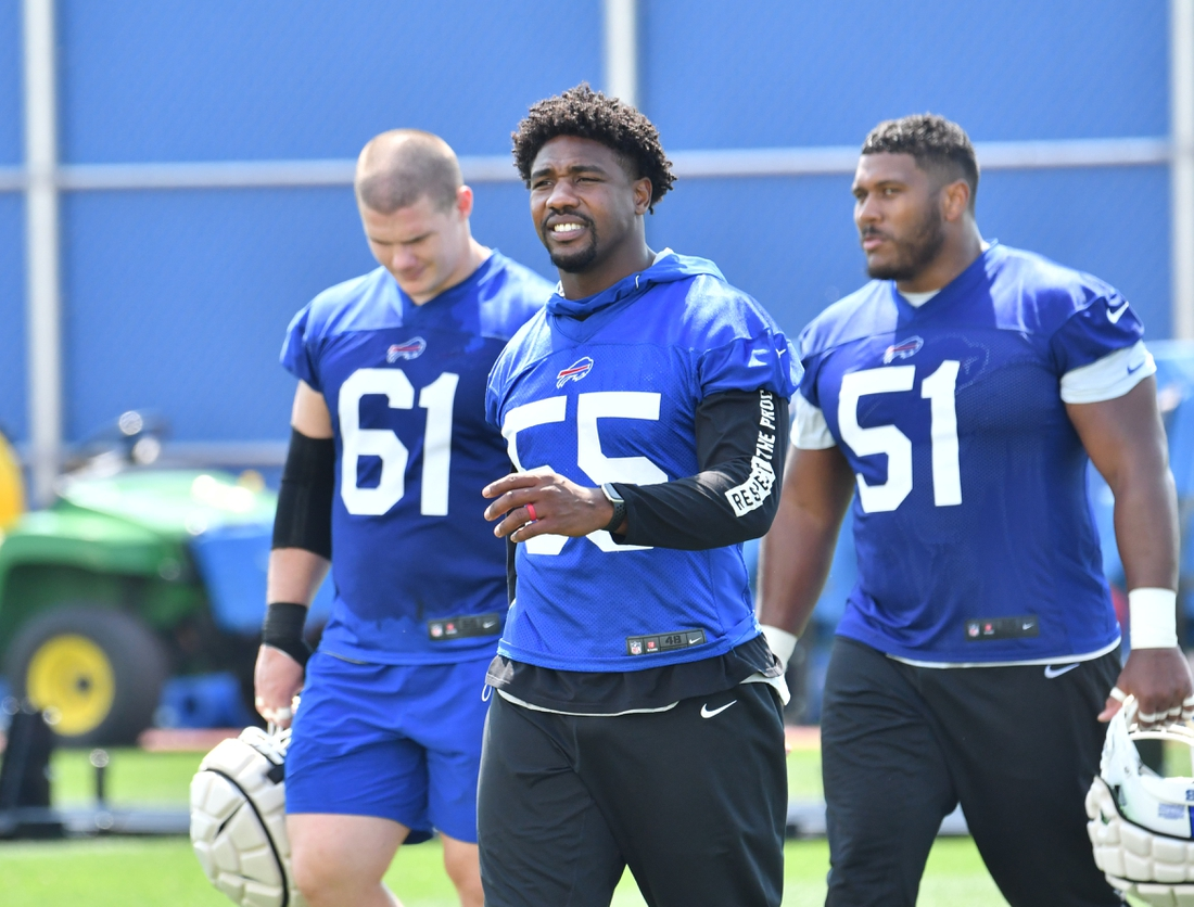 Jul 28, 2021; Orchard Park, NY, United States; Buffalo Bills defensive end Jerry Hughes (55) along with defensive tackle Justin Zimmer (61) and defensive end Bryan Cox (51) come off the field after practice at the Buffalo Bills Training Facility. Mandatory Credit: Mark Konezny-USA TODAY Sports