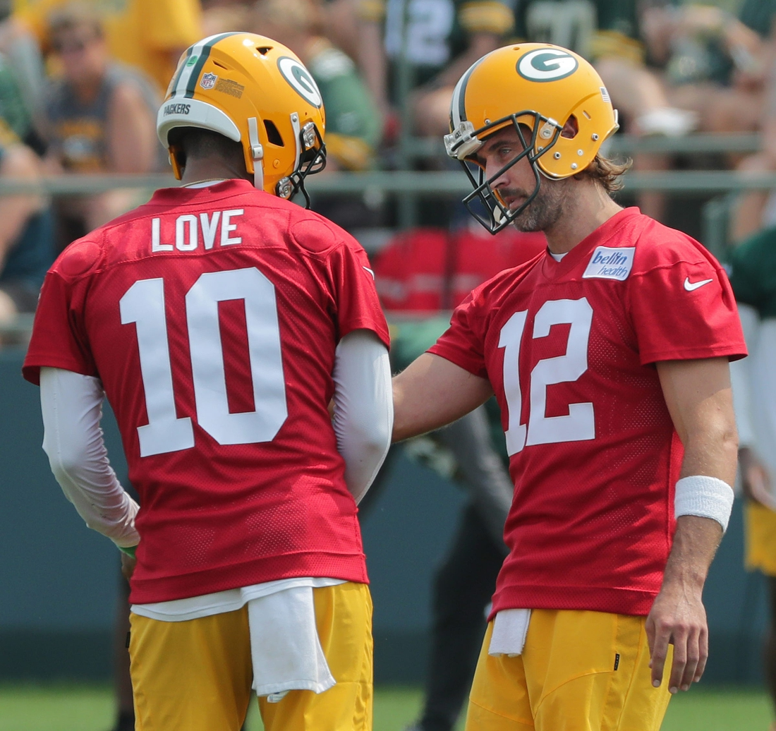 Green Bay Packers quarterback Aaron Rodgers (12) talks with quarterback Jordan Love (10) during the first day of training camp Wednesday, July 28, 2021 in Green Bay, Wis.  Mjs Packers29 6 Jpg Packers29