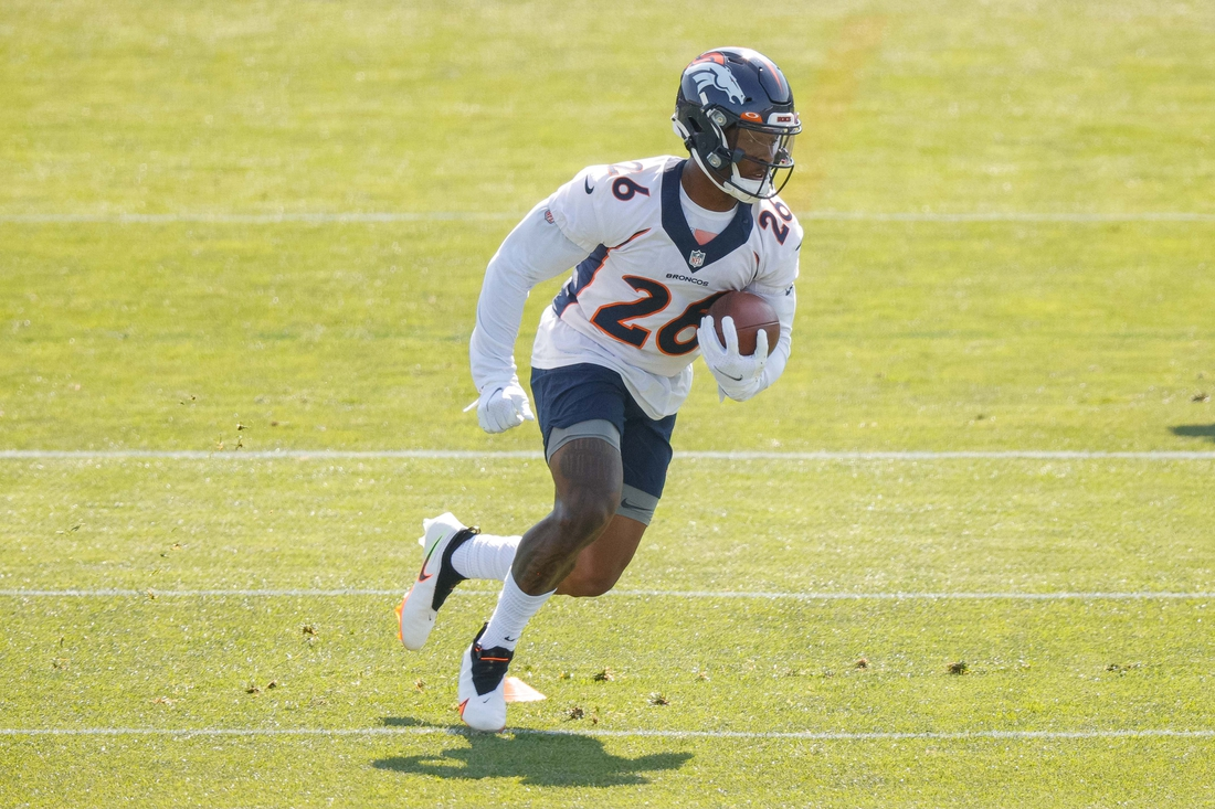 Jul 28, 2021; Englewood, CO, United States; Denver Broncos running back Mike Boone (26) during training camp at UCHealth Training Complex. Mandatory Credit: Isaiah J. Downing-USA TODAY Sports