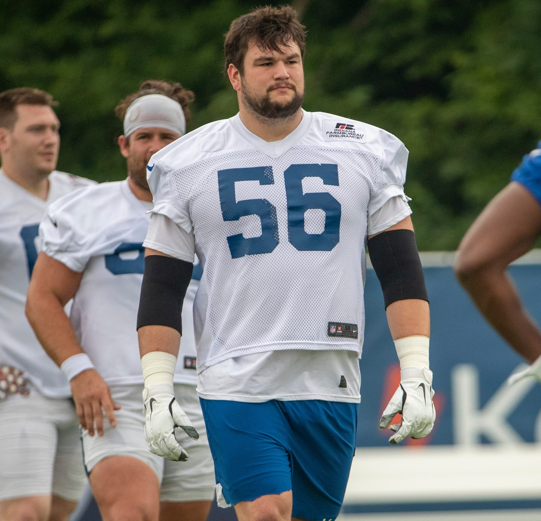Indianapolis Colts offensive guard Quenton Nelson (56) stretches at the start of practice at Grand Park in Westfield on Thursday, July 29, 2021, on the second full day of workouts of this summer's Colts training camp.  Colts Camp Revs Up