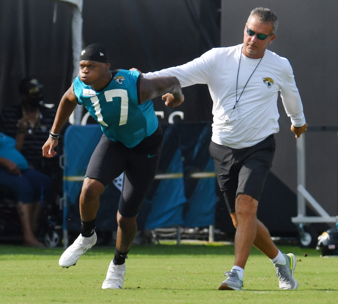 Jaguars head coach Urban Meyer holds WR (17) DJ Chark Jr. by the jersey as he works with him at the start of the Jacksonville Jaguars training camp session at the practice fields outside TIAA Bank Field in Jacksonville, FL Friday, July 30, 2021.  Jki 073021 Jagsfritrainingcamp 04