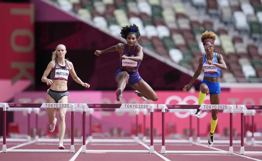 Jul 31, 2021; Tokyo, Japan; From left Sage Watson (CAN), Anna Cockrell (USA) and Yadisleidis Pedroso (ITA) race in the women's 400m hurdles round 1 during the Tokyo 2020 Olympic Summer Games at Olympic Stadium. Mandatory Credit: James Lang-USA TODAY Sports