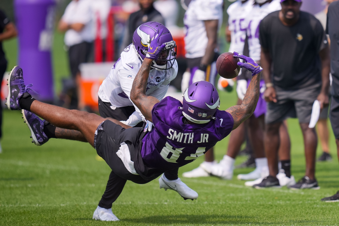 Jul 30, 2021; Eagan, MN, United States; Minnesota Vikings tight end Irv Smith Jr. (84) catches a pass at training camp at TCO Performance Center. Mandatory Credit: Brad Rempel-USA TODAY Sports