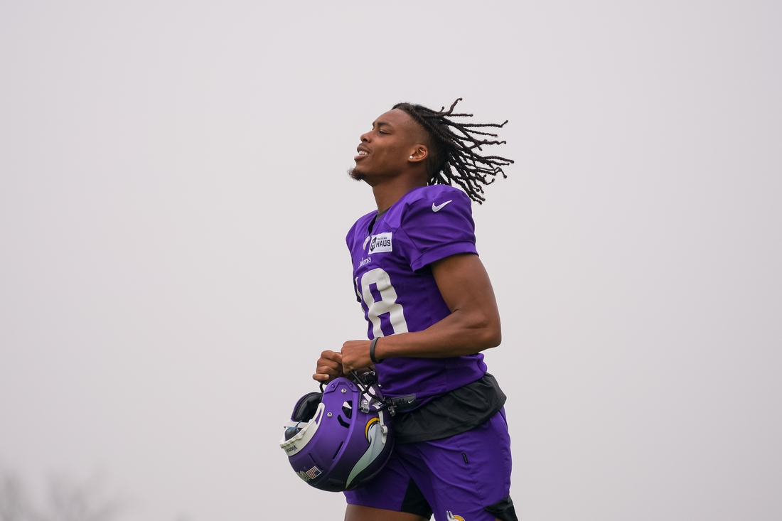 Jul 30, 2021; Eagan, MN, United States; Minnesota Vikings wide receiver Justin Jefferson (18) takes the field at training camp at TCO Performance Center. Mandatory Credit: Brad Rempel-USA TODAY Sports