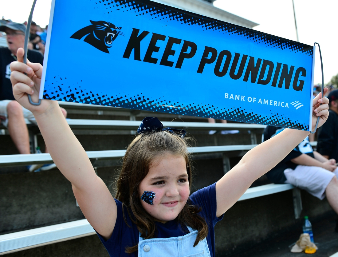 Kylie Koepke, 7, of Union shows her Panthers pride at the event.  Shj Panthers Back Together22