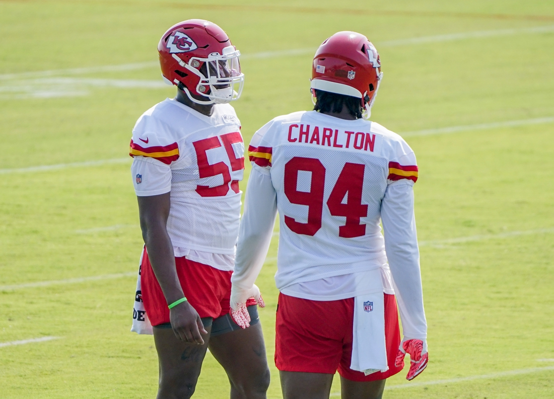 Jul 28, 2021; St. Joseph, MO, United States; Kansas City Chiefs defensive end Frank Clark (55) talks with defensive end Taco Charlton (94) in a break during training camp at Missouri Western State University. Mandatory Credit: Denny Medley-USA TODAY Sports