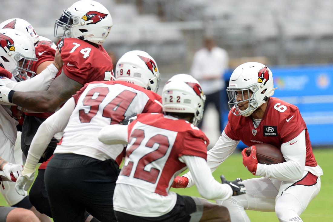 Aug 2, 2021; Phoenix, AZ, USA; Arizona Cardinals running back James Conner (6) runs with the ball during training camp at State Farm Stadium. Mandatory Credit: Joe Camporeale-USA TODAY Sports