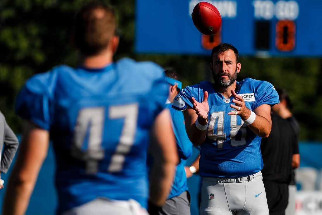 Detroit Lions long snapper Don Muhlbach (48) catches a ball from Bobby Price (47) during training camp at the practice facility in Allen Park, Wednesday, Aug. 4, 2021.