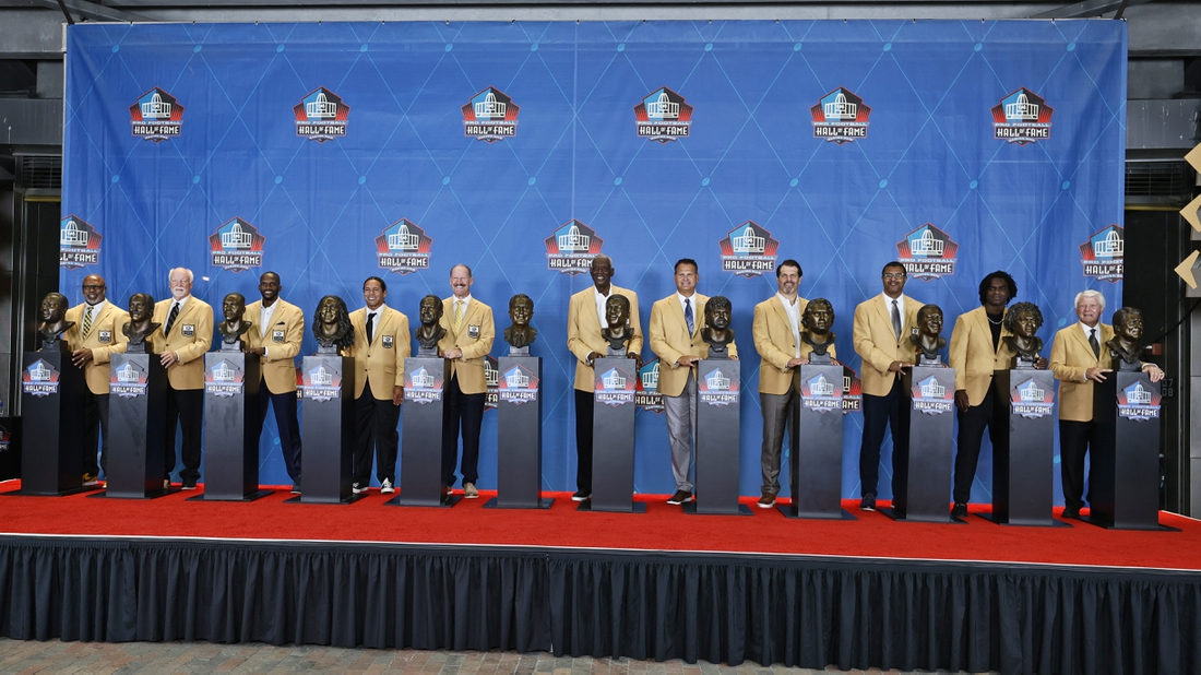 Aug 7, 2021; Canton, Ohio, USA; Members of the Pro Football Hall of Fame Centennial Class, Donnie Shell, left to right, Cliff Harris, Isaac Bruce, Troy Polamalu, Bill Cowher, Harold Carmichael, Jimbo Covert, Steve Hutchinson, Steve Atwater, Edgerrin James, Jimmy Johnson pose for a photo during the induction ceremony at the Pro Football Hall of Fame at Tom Benson Hall of Fame Stadium. Paul Tagliabue is not pictured. Mandatory Credit: Ron Schwane/Pool Photo via USA TODAY Sports