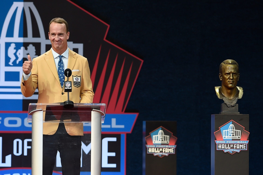 Peyton Manning gives a thumbs up to the left of his bust at the Class of 2021 Enshrinement at Tom Benson Hall of Fame Stadium in Canton, Ohio., on Sunday, Aug. 8, 2021.  Hpt 2021 Class Enshrinement Hof 23