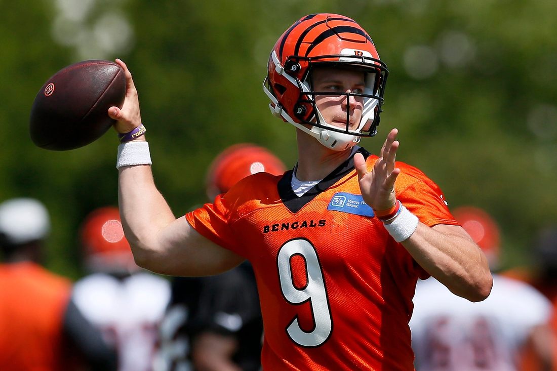 """Cincinnati Bengals quarterback Joe Burrow (9) throws a pass during a training camp practice at the Paul Brown Stadium practice facility in downtown Cincinnati on Thursday, Aug. 12, 2021. Air temperatures reached the upper 90s Thursday, with """"real feel"""" rising above 110 in the afternoon.  Cincinnati Bengals Training Camp"""