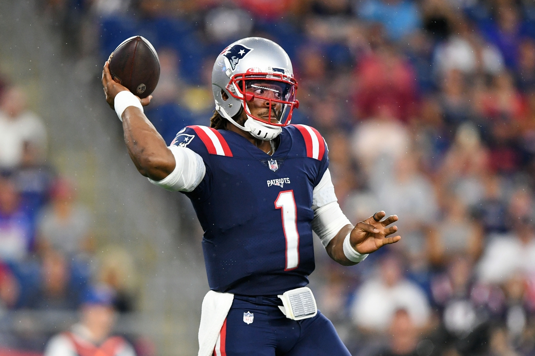 Aug 12, 2021; Foxborough, Massachusetts, USA; New England Patriots quarterback Cam Newton (1) throws the ball during the first half of a game against the Washington Football Team at Gillette Stadium. Mandatory Credit: Brian Fluharty-USA TODAY Sports