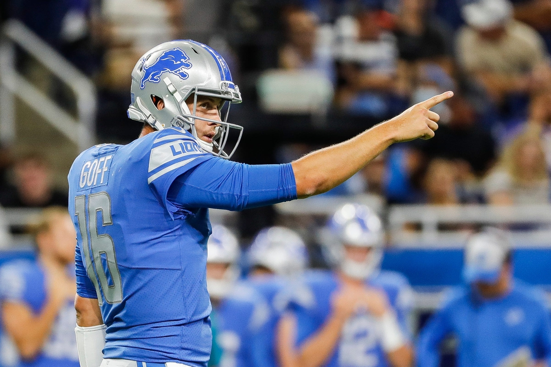 Lions quarterback Jared Goff (16) celebrates a first down against the Bills during the first half of the preseason game at Ford Field on Friday, Aug. 13, 2021.