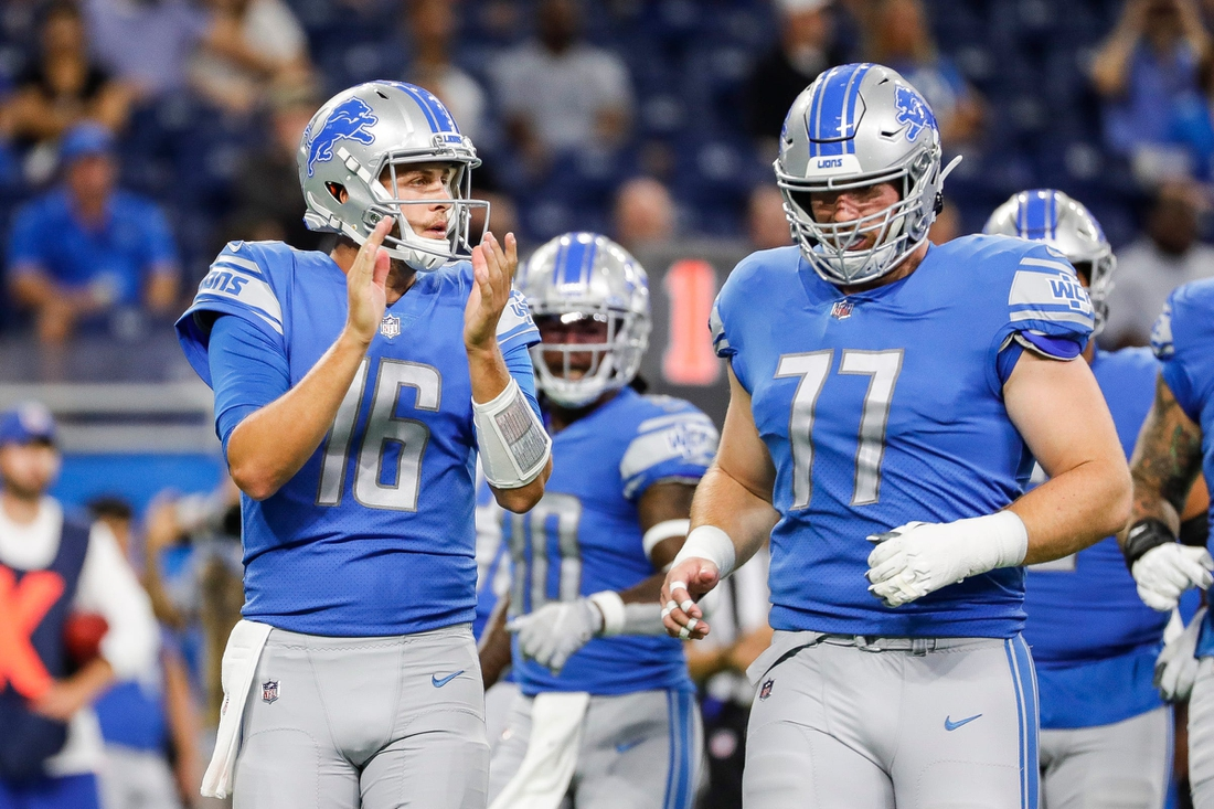 Detroit Lions quarterback Jared Goff (16) applauds as the team huddles before a play against Buffalo  during the first half of the preseason game  at Ford Field in Detroit on Friday, Aug. 13, 2021.