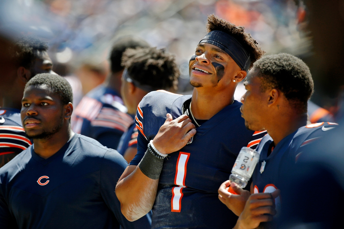 Aug 14, 2021; Chicago, Illinois, USA; Chicago Bears quarterback Justin Fields (1) smiles while watching the game against the Miami Dolphins during the first half at Soldier Field. Mandatory Credit: Jon Durr-USA TODAY Sports