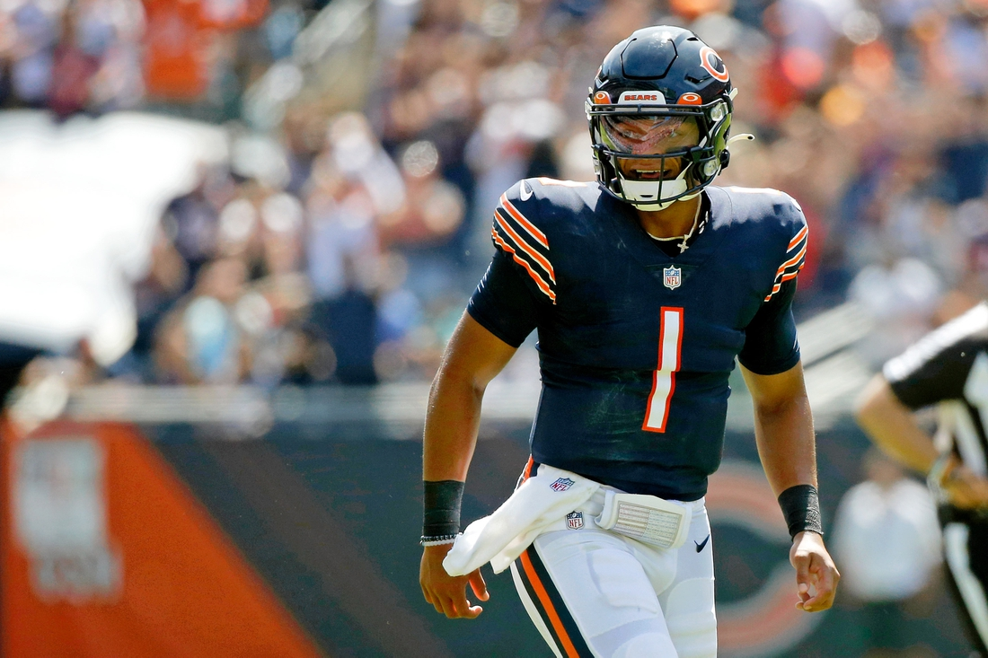 Aug 14, 2021; Chicago, Illinois, USA; Chicago Bears quarterback Justin Fields (1) celebrates his touchdown pass against the Miami Dolphins to tight end Jesse James (not pictured) during the second half at Soldier Field. Mandatory Credit: Jon Durr-USA TODAY Sports