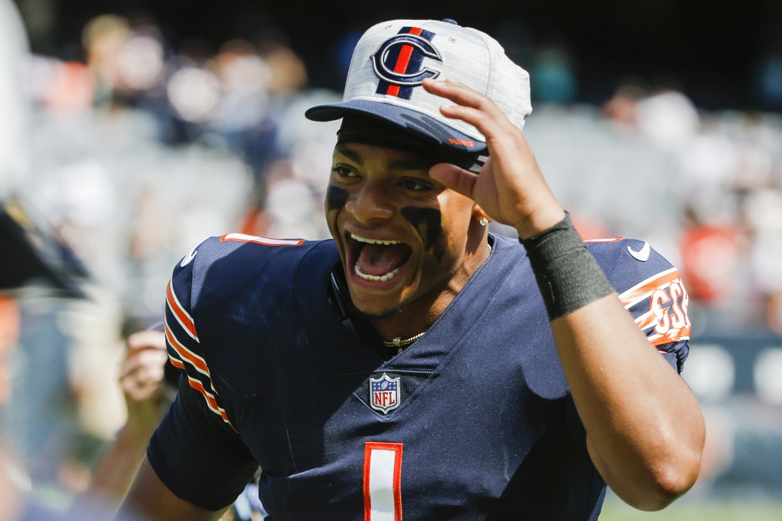 Aug 14, 2021; Chicago, Illinois, USA; Chicago Bears quarterback Justin Fields (1) celebrates their 20-13 win over the Miami Dolphins at Soldier Field. Mandatory Credit: Jon Durr-USA TODAY Sports