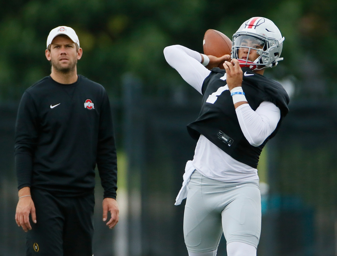 Ohio State Buckeyes quarterbacks coach Corey Dennis watches C.J. Stroud throw during football training camp at the Woody Hayes Athletic Center in Columbus on Wednesday, Aug. 18, 2021.  Ohio State Football Training Camp