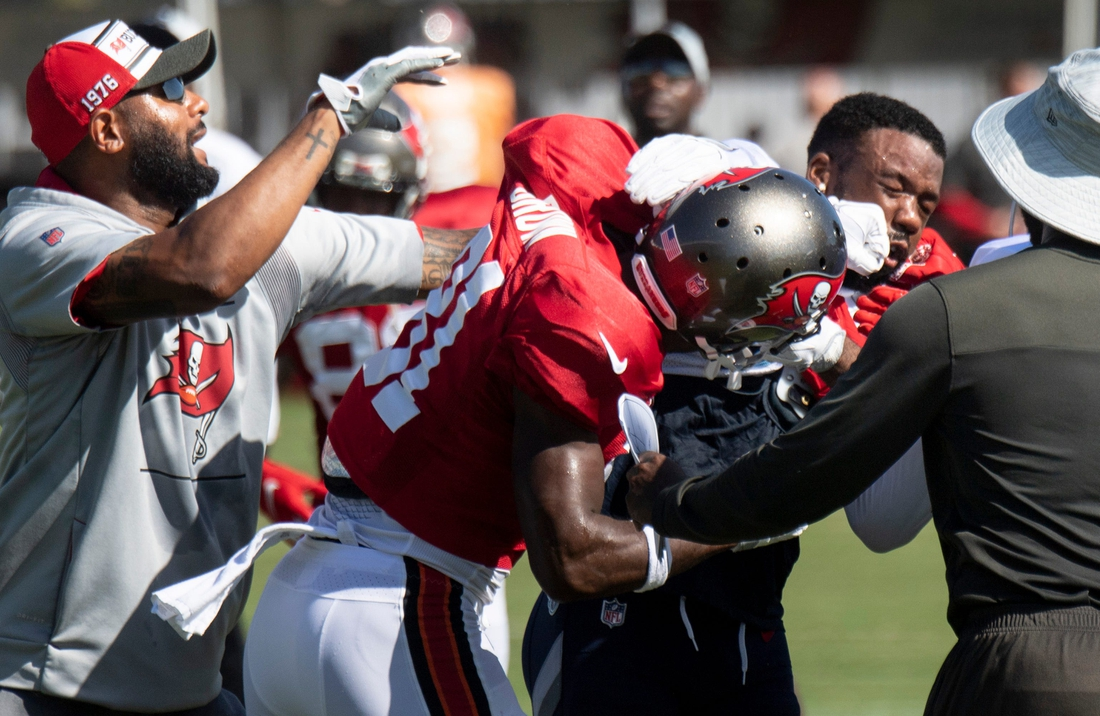 Tampa Bay Buccaneers wide receiver Antonio Brown (81) fights with Tennessee Titans defensive back Chris Jackson (35) during a joint training camp practice at AdventHealth Training Center Thursday, Aug. 19, 2021 in Tampa, Fla.  Nas Titans Bucs 009