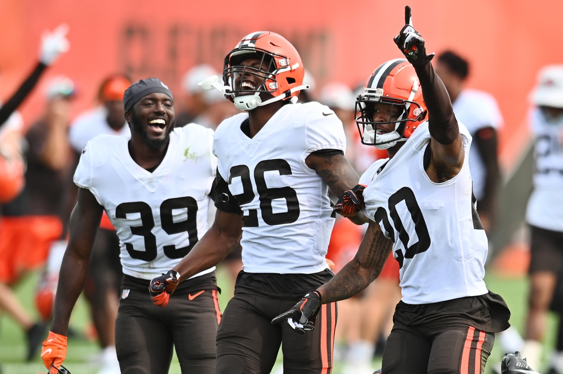 Aug 19, 2021; Berea, OH, USA; Cleveland Browns cornerback Greg Newsome II (20) celebrates with safety Richard LeCounte III (39) and cornerback Greedy Williams (26) after intercepting a pass during a joint practice with the New York Giants at CrossCountry Mortgage Campus. Mandatory Credit: Ken Blaze-USA TODAY Sports