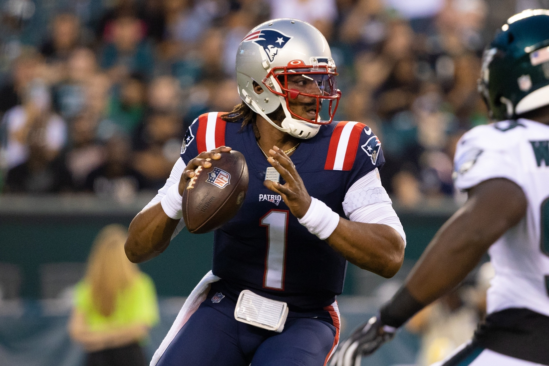Aug 19, 2021; Philadelphia, Pennsylvania, USA; New England Patriots quarterback Cam Newton (1) drops back to pass against the Philadelphia Eagles during the first quarter at Lincoln Financial Field. Mandatory Credit: Bill Streicher-USA TODAY Sports