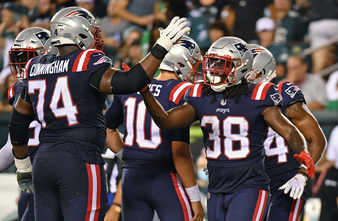 Aug 19, 2021; Philadelphia, Pennsylvania, USA; New England Patriots running back Rhamondre Stevenson (38) celebrates with offensive tackle Korey Cunningham (74)  after scoring a touchdown against the Philadelphia Eagles during the second quarter at Lincoln Financial Field. Mandatory Credit: Eric Hartline-USA TODAY Sports