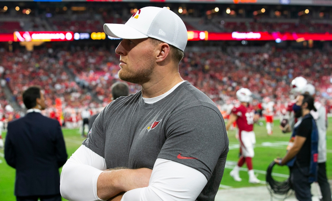Cardinals defensive end J.J. Watt looks on from the sideline during the first half of the preseason game against the Chiefs at State Farm Stadium in Glendale on August 20, 2021.  Cardinals Preseason