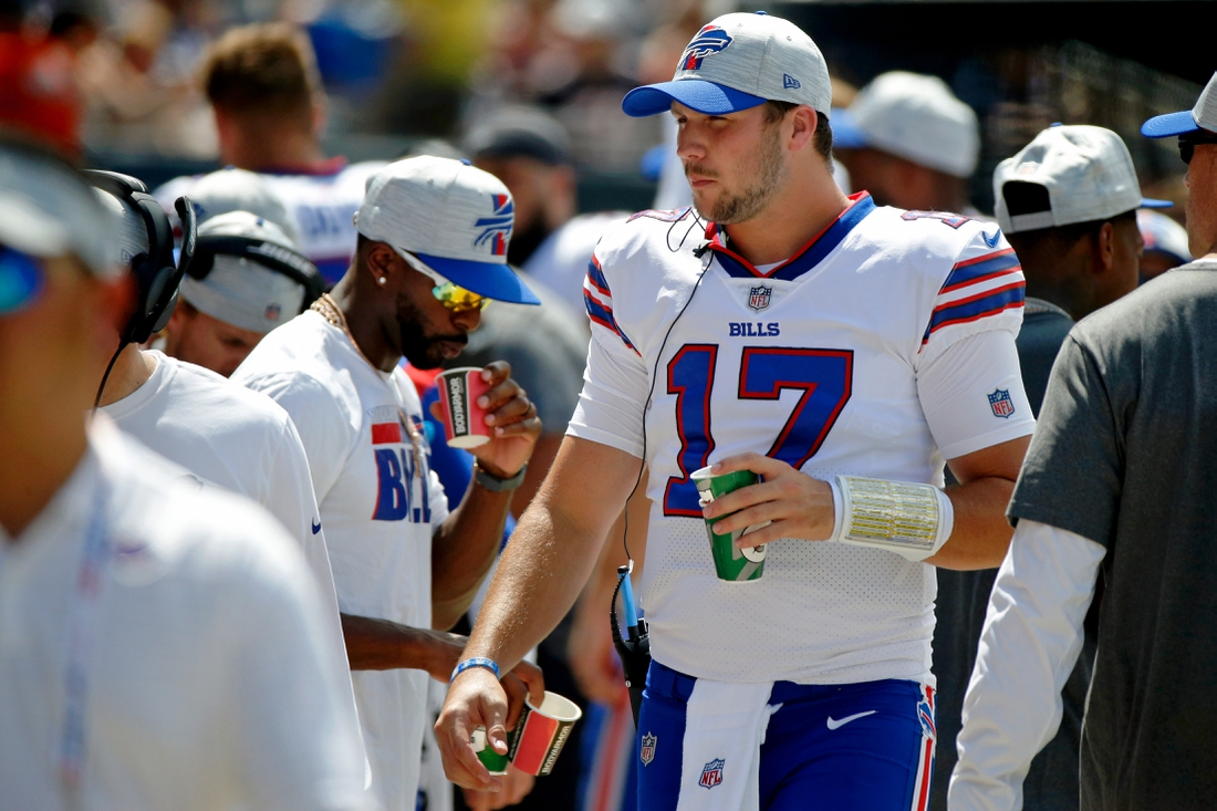 Aug 21, 2021; Chicago, Illinois, USA; Buffalo Bills quarterback Josh Allen (17) walks on the sideline against the Chicago Bears during the first quarter at Soldier Field. Mandatory Credit: Jon Durr-USA TODAY Sports