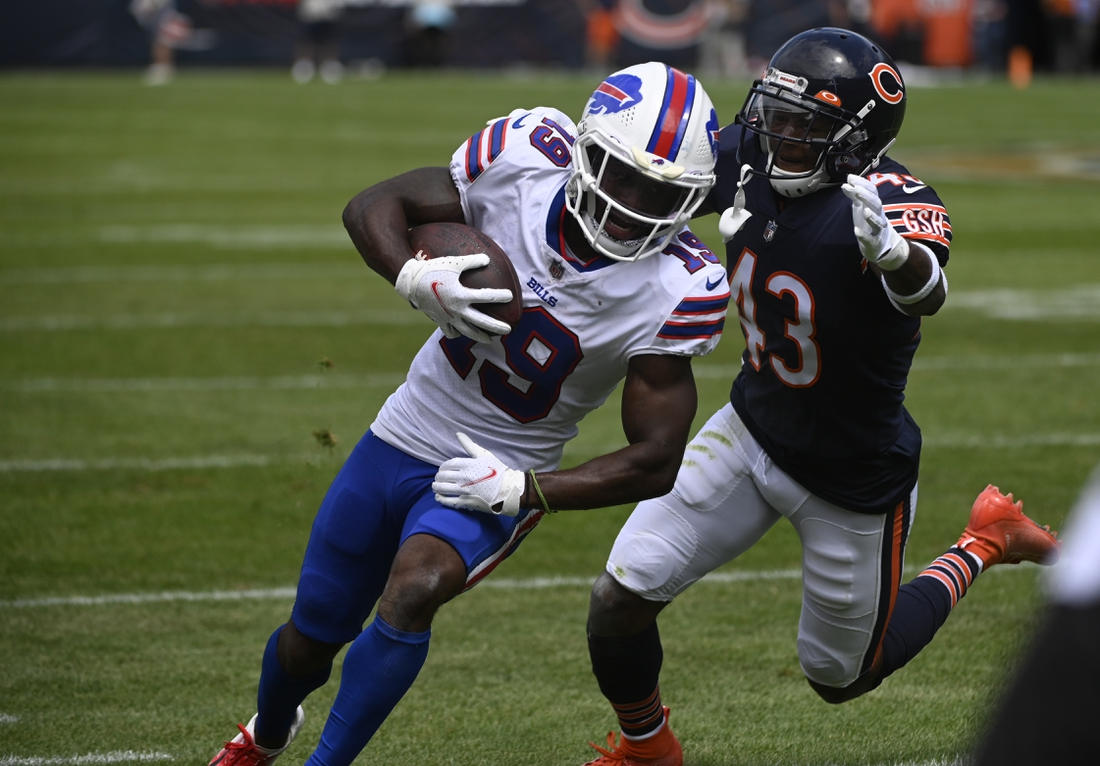 Aug 21, 2021; Chicago, Illinois, USA;  Buffalo Bills wide receiver Isaiah McKenzie (19) runs with the ball against Chicago Bears defensive back Marqui Christian (43) during the first half at Soldier Field. Mandatory Credit: Matt Marton-USA TODAY Sports